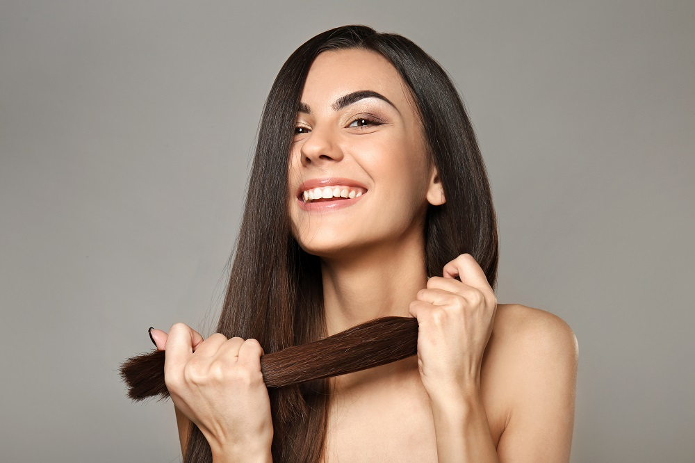4 At-Home Tips for Keeping Your Curly Hair Straight Between Salon Visits